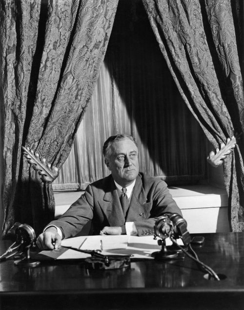 "President Roosevelt gives the first ""Fireside Chat"""