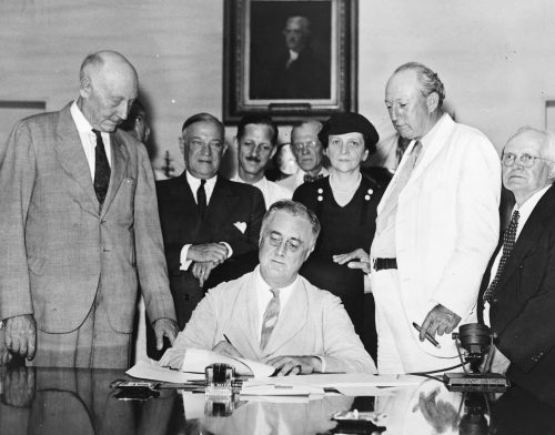 Roosevelt signs the Social Security Act into law