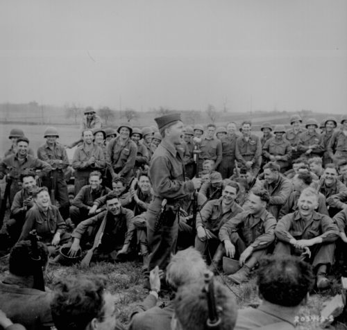 Famous Comedian Mickey Rooney entertains the troops